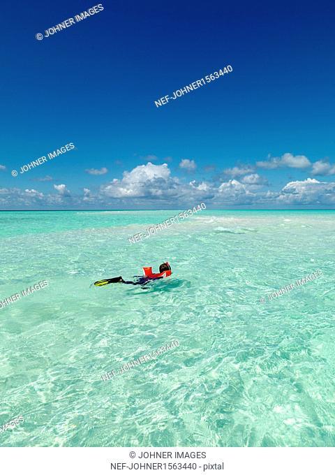 Boy diving in tropical sea