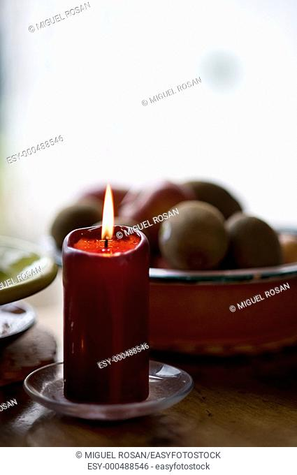 Homely atmosphere with candle burning on the kitchen table