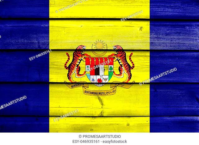 Flag of Putrajaya, Malaysia, painted on old wood plank background