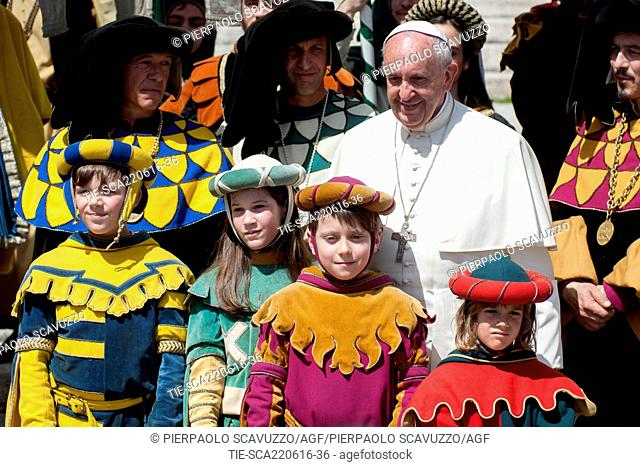 Pope Francis with children of Historical group City of Arezzo    . General Papal audience St. Peter's Square. Vatican City