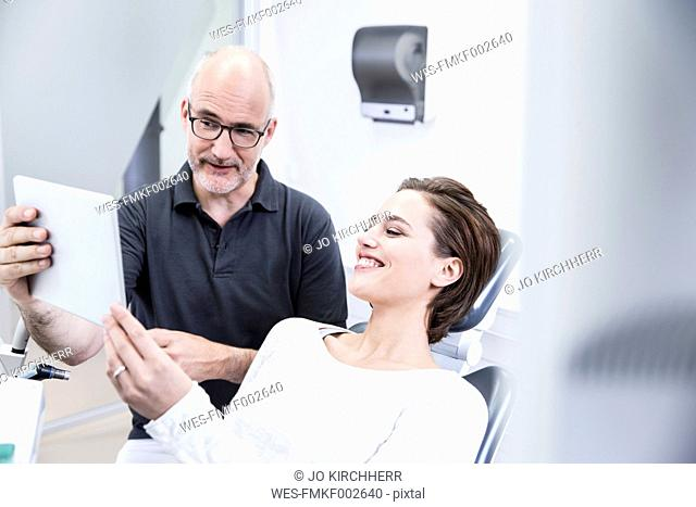 Young woman consulting dentist