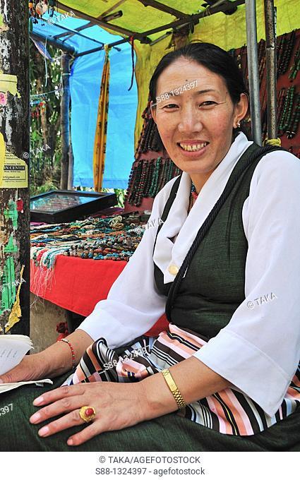 Tibetan woman selling traditional Tibetan accessories on the street