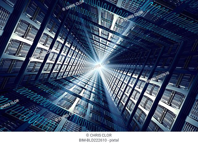 Light shining from binary code and computer servers