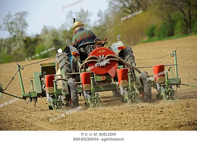 farmer on a tractor ploughing his acre, Austria