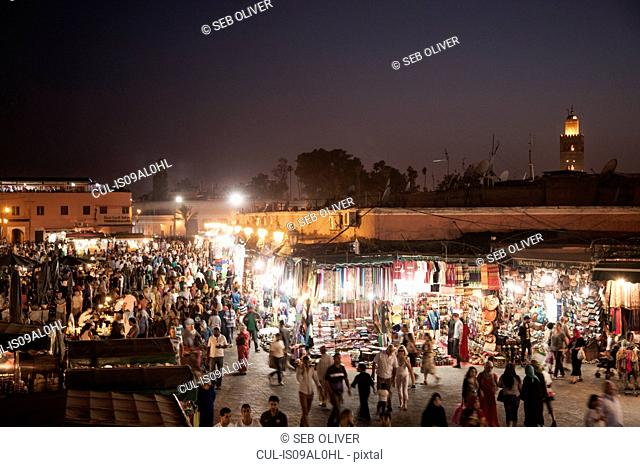 Crowded market stalls at night, Jamaa el Fna Square, Marrakech, Morocco