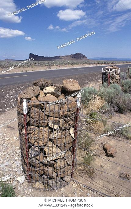 Rock Fence Post: Stones enclosed by Wire Mesh, Wooden Posts are scarce, Fort Rock, Oregon