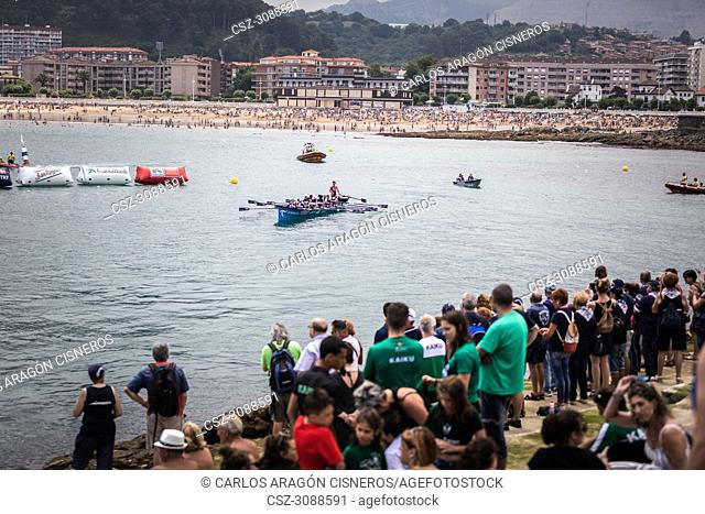 CASTRO URDIALES, SPAIN - JULY 15, 2018: Competition of boats, regata of trainera, Urdaibai Avia boat greets the public after winning the competition VI Bandera...