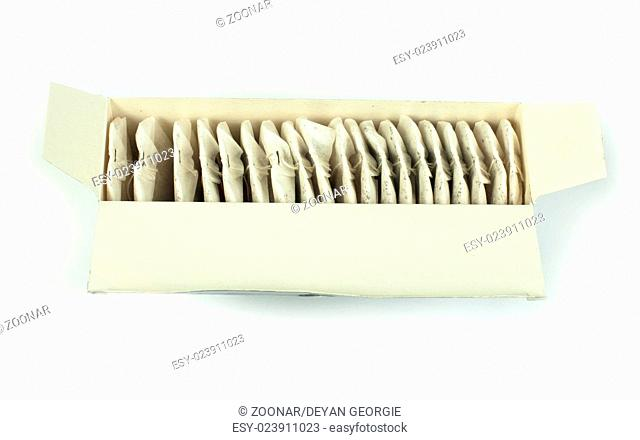Tea bags white isolated in box