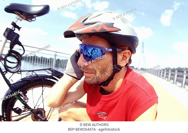 Cyclist talking on mobile