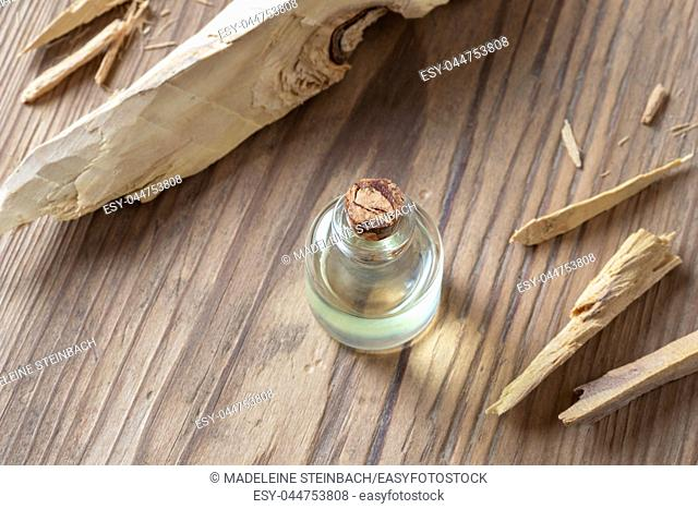 A bottle of essential oil with white sandalwood