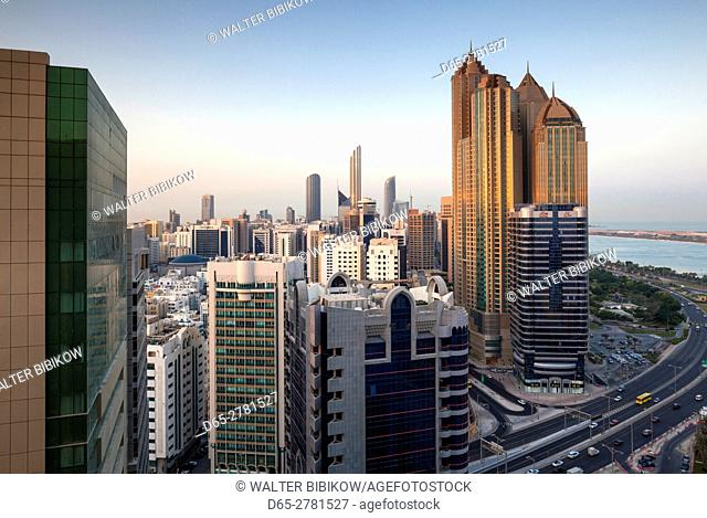 UAE, Abu Dhabi, elevated skyline from Corniche Road East, dawn