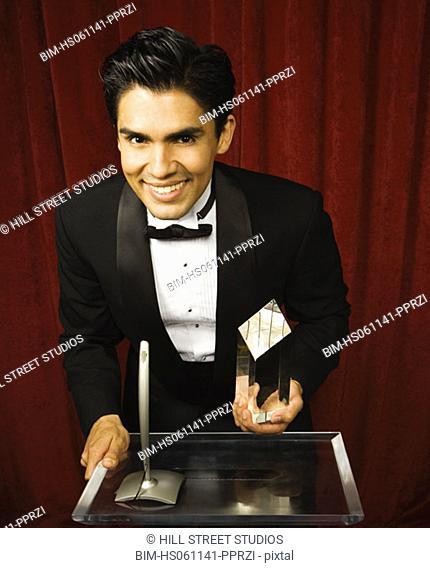 Young man accepting an award