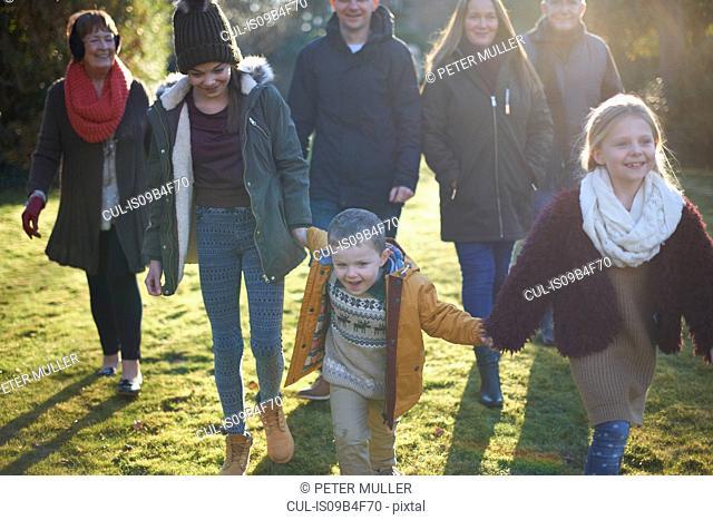 Family enjoying sun in garden