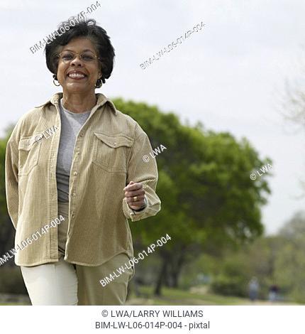 Senior African woman walking in park