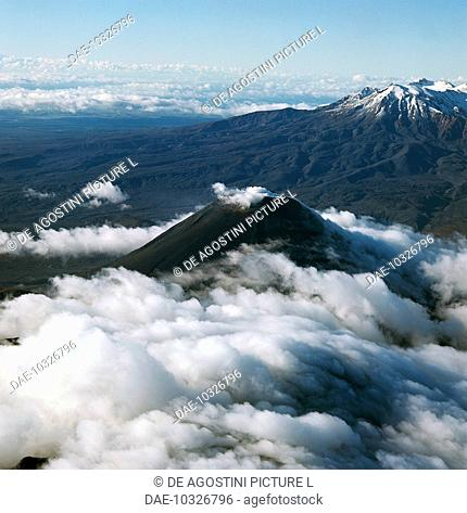 The Ngauruhoe volcanoes in the foreground, and Mount Ruapehu in the background. Tongariro National Park (UNESCO World Heritage List, 1993), North Island