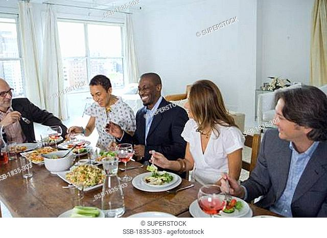 Friends sitting at the dining table