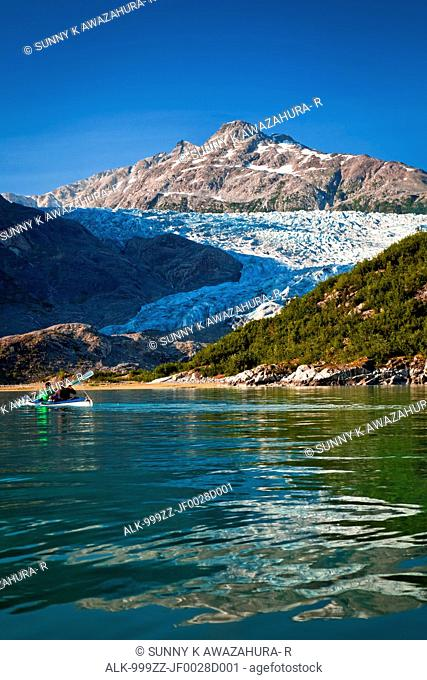 Sea Kayakers paddling to Riggs Glacier in Muir Inlet, Glacier Bay National Park & Preserve, Southeast Alaska, Summer
