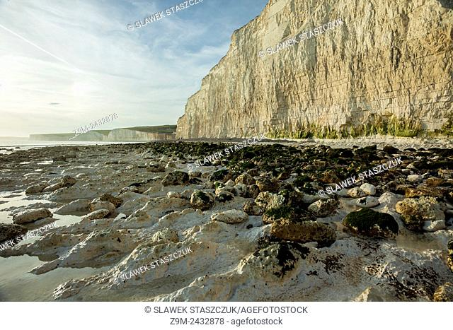 White cliffs of Beachy Head near Eastbourne, Sussex, England. Seven Sisters looming in the background