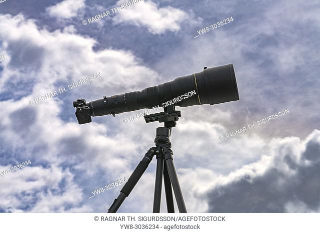 Camera on a tripod with a long lens, 800mm