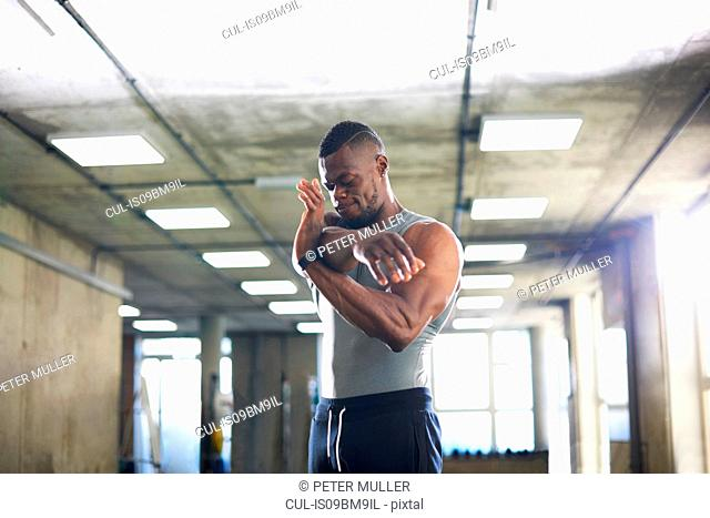 Man doing stretching exercise in gym