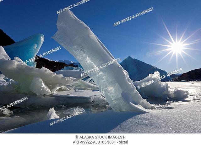Scenic of large icebergs frozen in Mendenhall Lake on a sub zero sunny day, Inside Passage, Southeast Alaska, Winter