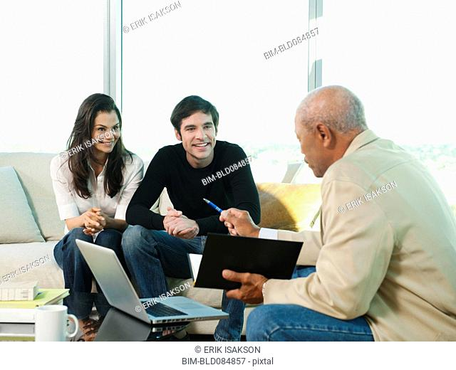 Couple talking to financial advisor