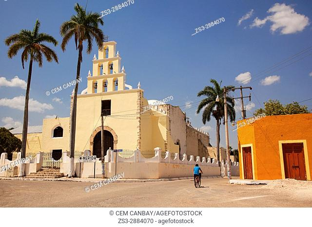 Cyclist in front of the church at the town center, Chumayel, Convent Route, Yucatan Province, Mexico, Central America