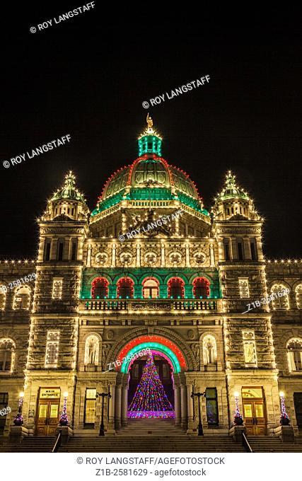 British Columbia legislative buildings illuminated in Christmas colours