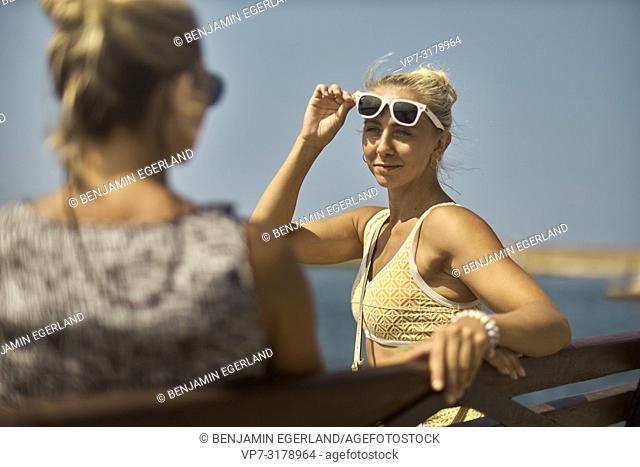 two women in Chania, Crete, Greece