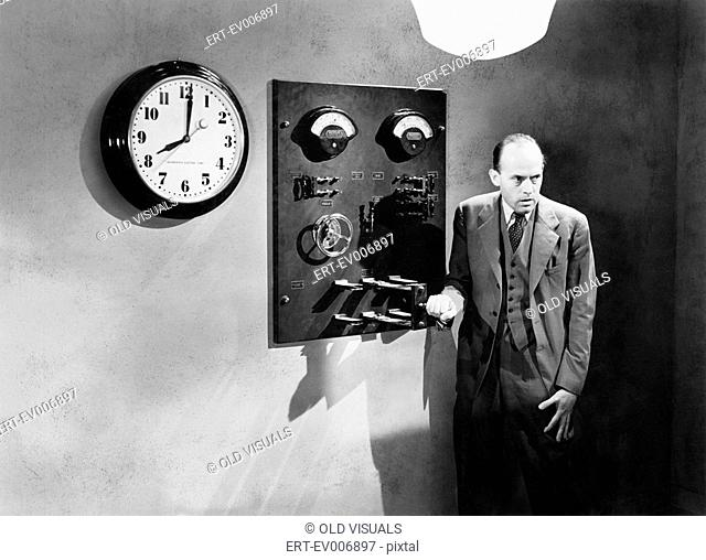 Man standing next to an electrical switch All persons depicted are not longer living and no estate exists Supplier warranties that there will be no model...