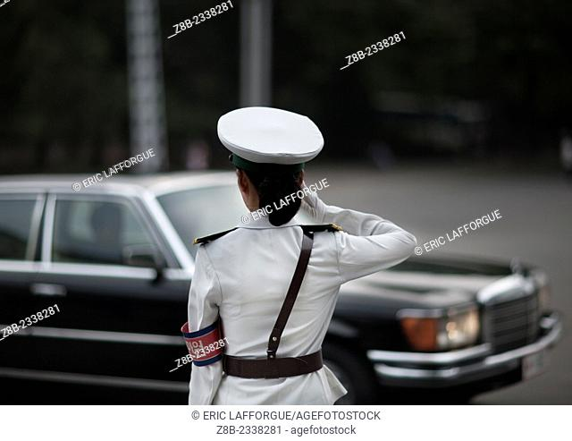 Traffic Officer In Front Of A Mercedes, Pyongyang, North Korea