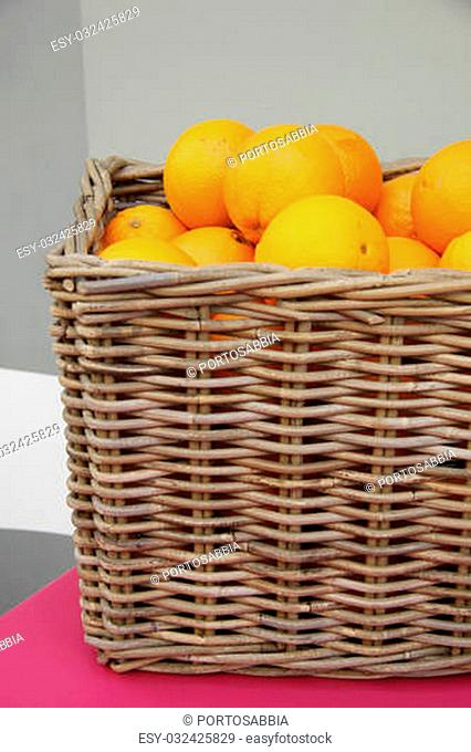 a wicker basket filled with juicy oranges