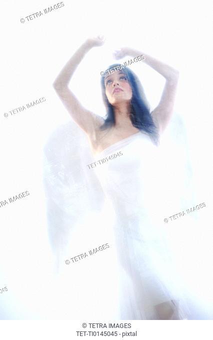 Studio shot of beautiful angel