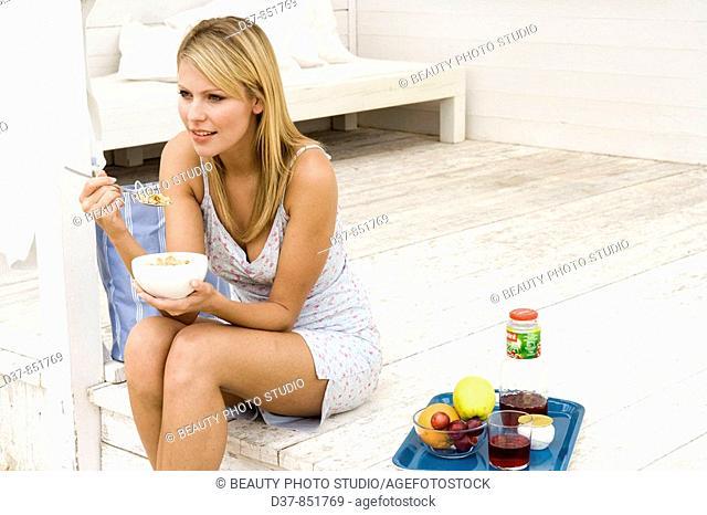 Woman having breackfast in the terrace