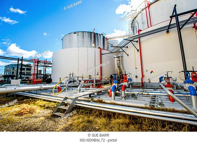 Storage tanks and pipes at biofuel industrial plant