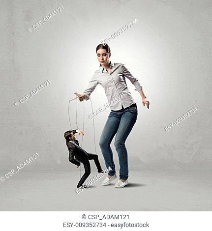 puppeteer controls a businessman