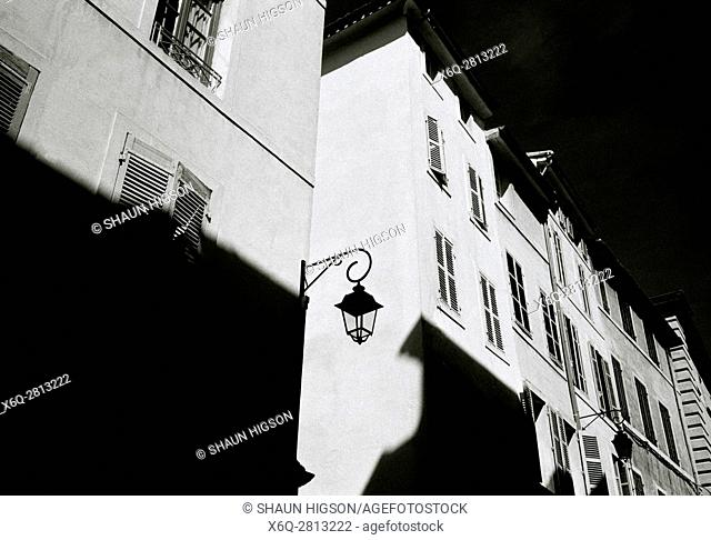 Buildings in chiaroscuro in a street in central Aix en Provence in Provence Alpes Cote d'Azur in France in Europe