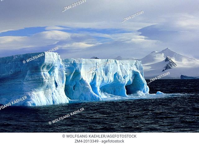 ANTARCTICA,TABULAR ICEBERG WITH CAVES & ARCHES, MT. BRANSFIELD, ANTARCTIC PENINSULA BACKGROUND