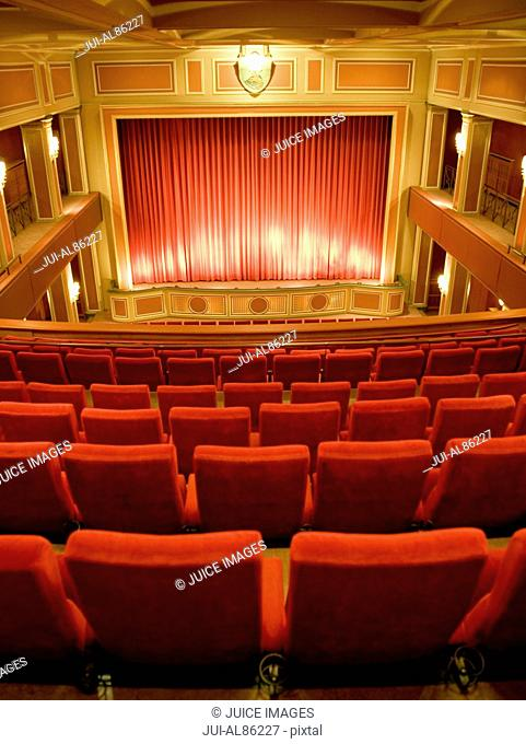 Balcony seating and stage in empty theater