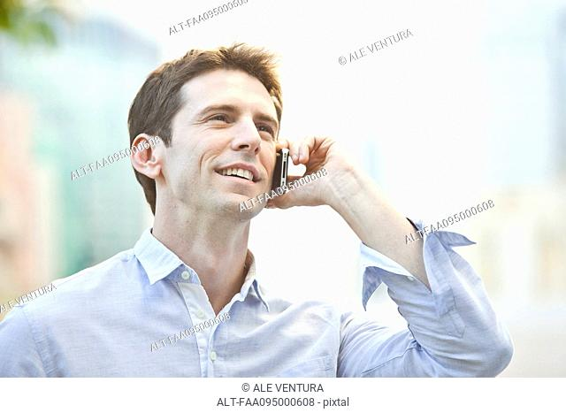Mid-adult man using cell phone, portrait