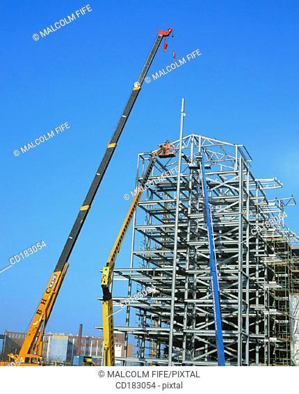 Cranes and flats under construction