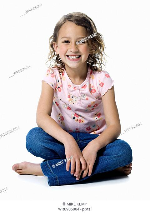 Portrait of a girl sitting with her legs crossed