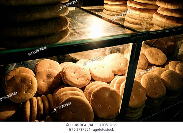Showcase full of basic Moroccan bread in bakery. Fez, Morocco