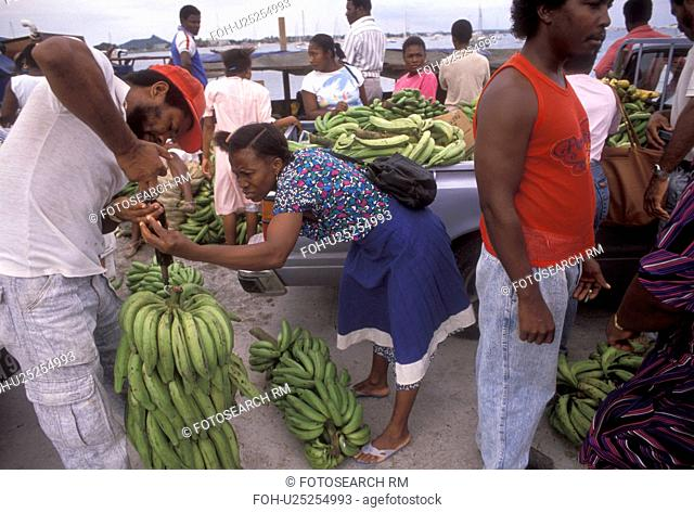 St. Martin, Caribbean, Marigot, Caribbean Islands, Local people weighing bananas right off the boat in Marigot's harbor the French capital of the island of...