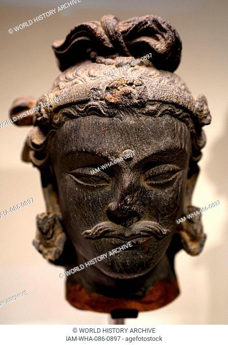 Head of bodhisattva Maitreya from Afghanistan. Dated 1st Century