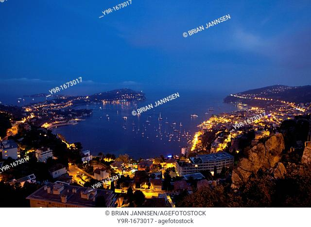 Dusk view of Villefranche-sur-mer with the peninsula of Saint-Jean and Cap-Ferrat beyond, Provence France