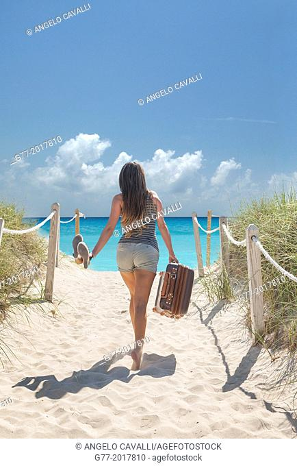 Usa. Florida. Miami Beach. Woman with nag going to the beach