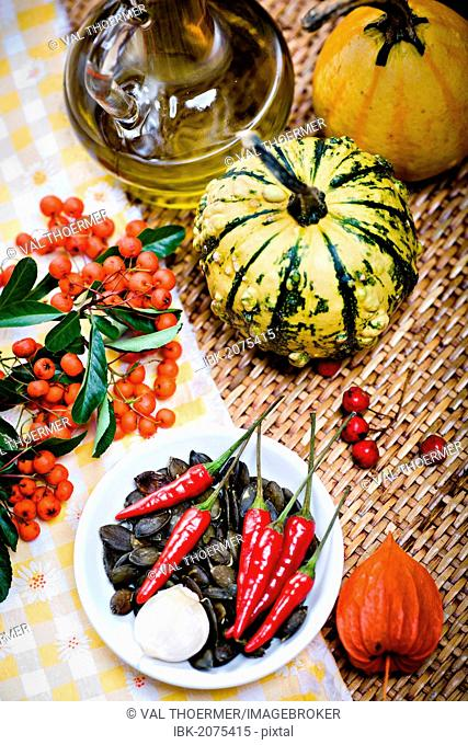 Gourds, pumpkin seeds, chili peppers, lantern flower or physalis, red berries