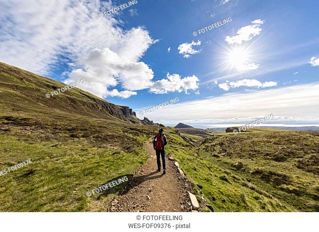 UK, Scotland, Inner Hebrides, Isle of Skye, Trotternish, Quiraing, tourist on hiking trail