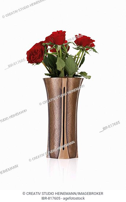 Red roses in a vase, grave decoration